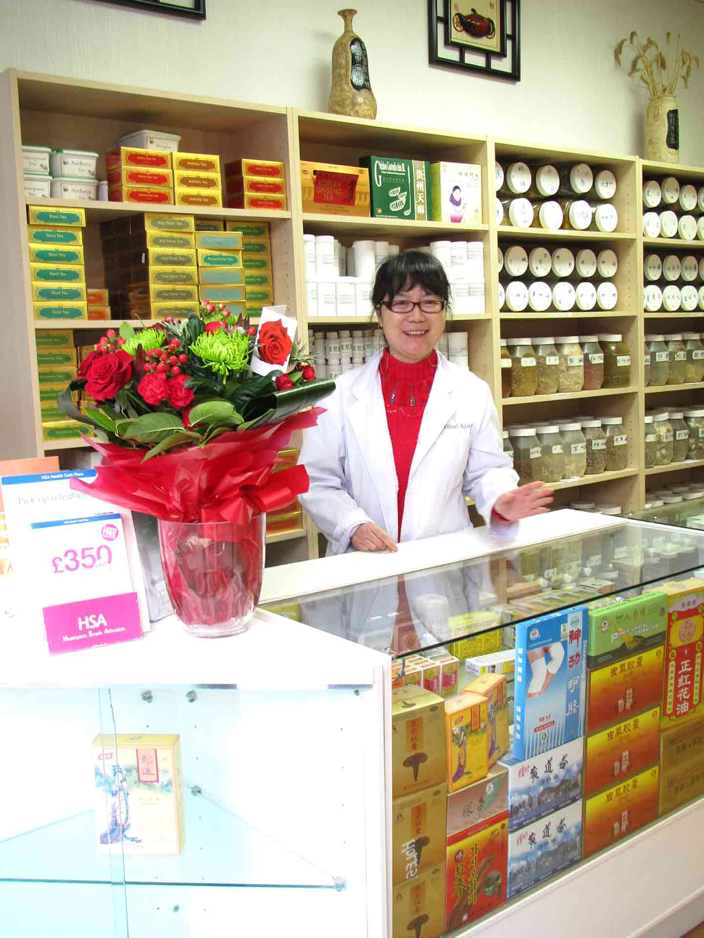 Yilan At The Herbal King Shop Counter In Sutton, Surrey